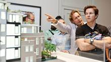 Mike Wekerle shows Mark Wahlberg the plans for Wahlberg's newly purchased Toronto condo in this file photo. (JENNIFER ROBERTS/JENNIFER ROBERTS for The Globe and Mail)