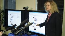 Paula Selis, senior counsel for Washington state's Attorney general, talks to reporters about a new legal strategy to combat scams on Facebook that trick users into clicking on them, in Seattle on Jan. 26, 2012. (Ted S. Warren/AP/Ted S. Warren/AP)
