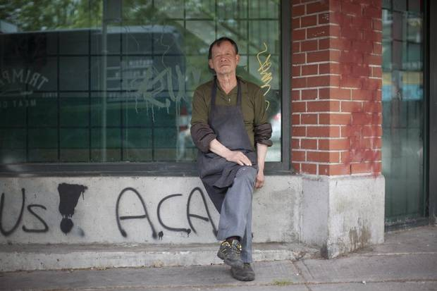 A worker from Tin Lee Market in Vancouver's Chinatown takes a break.