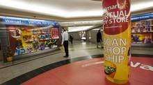Pedestrians pass by a Mattel/Walmart Toy display in the underground PATH system near Union Station in Toronto. (Deborah Baic/The Globe and Mail)