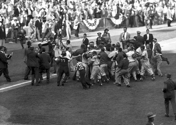 Fans and Brooklyn Dodgers players celebrate the Brooklyn Dodgers' victory over the New York Yankees in the seventh and deciding game of the World Series, Oct. 4, 1955, at Yankee Stadium in New York. Dodgers pitcher Johnny Podres is at the center of the celebration. The first Subway Series in 44 years was finalized about 12:15 a.m. Wednesday, Oct. 18, 2000 when the New York Yankees joined the New York Mets in the Fall Classic for the first time in history.