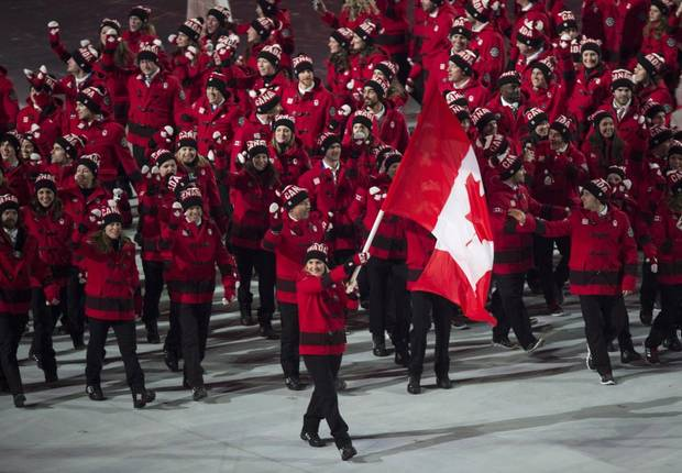 Hayley Wickenheiser leads the Canadian team into the stadium during opening ceremonies at the Sochi Winter Olympics Friday, February 7, 2014 in Sochi.