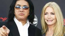 Kiss singer Gene Simmons and actress Shannon Tweed arrive at the 2007 American Music Awards in Los Angeles, California in this November 18, 2007 file photo. Gene Simmons, frontman of the band Kiss, and his girlfriend of 28 years, the actress and former Playmate Shannon Tweed, were married this weekend before 400 guests. (MARIO ANZUONI/Reuters)