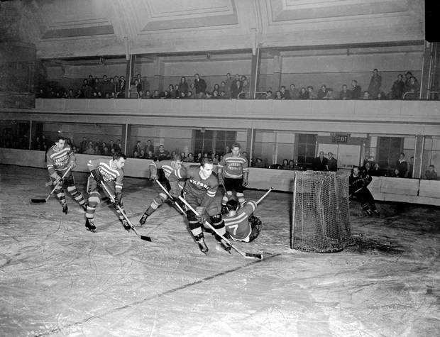 A varsity hockey match between The Oxford Dark Blues and Cambridge Light Blues, Feb. 22, 1957. The teams have been battling each other on the ice for more than 130 years'