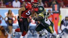 Calgary Stampeders Jon Cornish (L) gets past Edmonton Eskimos Almondo Sewell during the first half of their CFL game in Calgary, Alberta, September 28, 2012. (TODD KOROL/REUTERS)