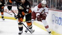 Phoenix Coyotes right wing Radim Vrbata battles Anaheim Ducks defenseman Sheldon Souray (Chris Carlson/The Associated Press)