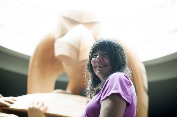 Nika Collison stands in front of Bill Reid's iconic sculpture The Raven and The First Men.