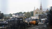 Wagons are pictured on the site of the train wreck in Lac Megantic, July 16, 2013. REUTERS/Ryan Remiorz/Pool (POOL/REUTERS)