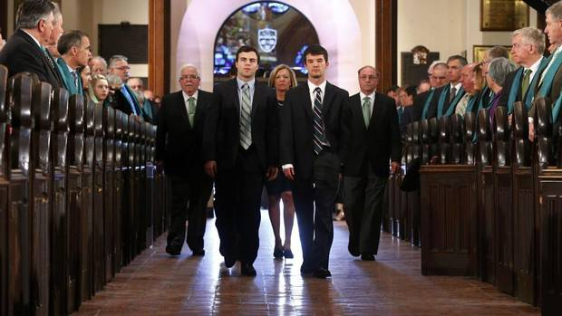 The wife of former finance minister Jim Flaherty, Christine Elliott, centre, and his sons, Galen, Quinn, and John, arrive for his state funeral in Toronto, April 16, 2014. (Mark Blinch/Reuters)
