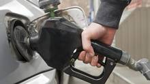 A motorist puts gas in his care in Montreal in this Apr. 4, 2012 file photo. (Graham Hughes/The Globe and Mail)