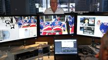 Former coach and Senior Vice-President of Hockey Operations Mike Murphy, watches NHL teams play in the National Hockey League video room, where he and other staff review goals, hits, penalties and other aspects of all the NHL games being played on March 15, 2012 in Toronto. (Deborah Baic/The Globe and Mail)