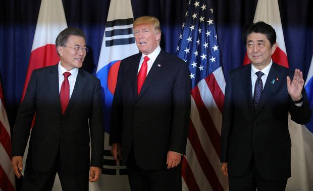 U.S. President Donald Trump meets South Korea's President Moon Jae-In (left) and Japanese Prime Minister Shinzo Abe (right) ahead the G20 leaders summit in Hamburg, Germany July 6, 2017.