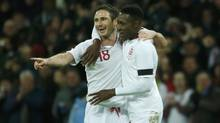 England's Frank Lampard, left, celebrates with teammate Daniel Welbeck after scoring against Brazil during their international friendly soccer match at Wembley stadium in London February 6, 2013. (EDDIE KEOGH/REUTERS)