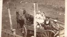 A detail from a hitherto-unseen photo of Tom Thomson, at front of wagon, holding the reins. The image will be displayed at the Art Gallery of Ontario Oct. 3.