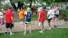 The end of each race ends in a circle, involving drinking, singing and initiations. (Robin Esrock/Robin Esrock)
