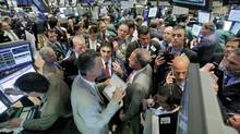 Traders crowd the post that handles Visa on the floor of the New York Stock Exchange, Friday June 27, 2008. W (Richard Drew/AP)