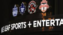 Photos of team logos above the entrance to Maple Leaf Sports and Entertainment located at the Air Canada Centre at 50 Bay St. on Dec 1 2010. (Fred Lum/The Globe and Mail) (Fred Lum/The Globe and Mail)