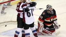 Ottawa Senator goaltender Robin Lehner(40) looks on as Colorado Avalanche's Andre Benoit (61) celebrates his goal with teammate Maxime Talbot (25) during second period NHL action in Ottawa, Sunday March 16, 2014. (FRED CHARTRAND/THE CANADIAN PRESS)