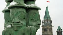Haida artist Chief James Hart's sculpture The Three Watchmen graces Parliament Hill on Jan. 23, 2012 ahead of a landmark Crown-first nations gathering. (Sean Kilpatrick/Sean Kilpatrick/The Canadian Press)