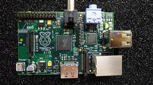 The Raspberry Pi is a credit card-sized motherboard, sold without a case, which can be connected to a TV, monitor, mouse or keyboard. (By Liz (http://www.raspberrypi.org) [Public domain], via Wikimedia Commons)