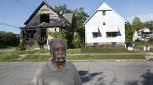 Albert Green, 86 years old, stands outside his well-kept home that sits next to a burnt, blighted, vacant home in the Delray neighbourhood of Detroit. Mr. Green and his wife of 68 years have lived in the home for 56 years where they raised four children. (REBECCA COOK FOR THE GLOBE AND MAIL)