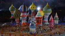 Performers take part as onion-dome floats rise above during the opening ceremony of the 2014 Sochi Winter Olympics, February 7, 2014. (MARK BLINCH/REUTERS)