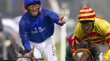 Frankie Dettori celebrates after winning the Gold Cup horse race with Colour Vision (Alastair Grant/AP)