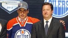 Nail Yakupov, left, a winger from Russia who was chosen first overall by the Edmonton Oilers in the first round of the NHL hockey draft, stands with Oilers general manager Steve Tambellini on Friday, June 22, 2012, in Pittsburgh. (Keith Srakocic/AP)