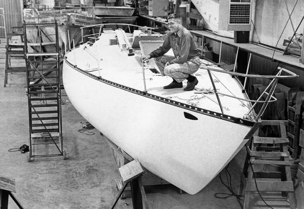 George Cuthbertson, president of C&C Yachts Ltd., inspects the hull of new craft at the Oakville plant in June, 1976.