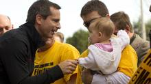 Ontario Liberal Leader Dalton McGuinty greets a baby during a campaign stop in Bolton, Ont. on Oct. 4, 2011. (Frank Gunn/The Canadian Press/Frank Gunn/The Canadian Press)