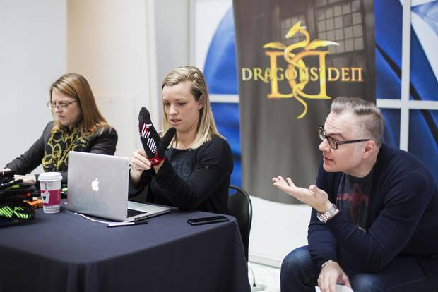 Dragons' Den producer Michelle MacMillan, centre, tries on a glove designed for use with touchscreens during auditions for the show.