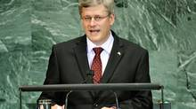 Prime Minister Stephen Harper addresses the Millennium Development Goals Summit at United Nations headquarters in New York on Sept. 21, 2010. (EMMANUEL DUNAND/AFP/Getty Images)