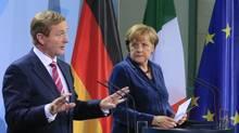 Irish Prime Minister Enda Kenny, left, and German Chancellor Angela Merkel address the media after talks in Berlin, Nov. 1, 2012. (TOBIAS SCHWARZ/REUTERS)