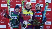 Marielle Thompson (centre) of Canada celebrates her first place finish with Fanny Smith (left) of Switzerland who finished second and Ophelie David of France who finished third in the women's World Cup ski cross event in Nakiska, Alta., Saturday, Dec. 7, 2013. (Todd Korol/THE CANADIAN PRESS)