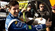 Alex Tagliani laughs at the giant steering wheel his crew put in his car before he went out and won the pole for the NAPA Auto Parts 200 NASCAR Nationwide race Friday, August 17, 2012 at the Circuit Gilles Villeneuve in Montreal. (File photo) (Ryan Remiorz/CP Photo)