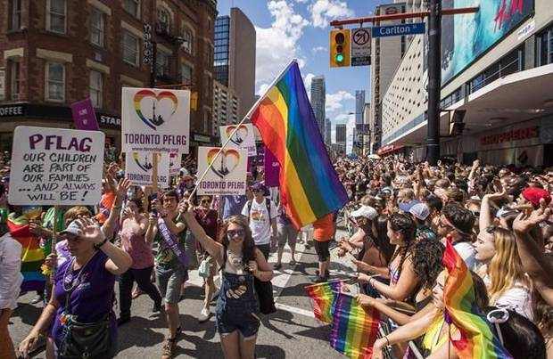 People march during the annual Toronto Pride Parade, in Toronto on Sunday, July 3, 2016.