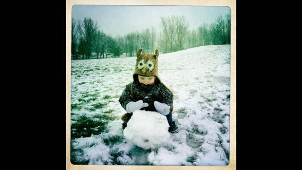 Will rolling a snowball for a snowman. Give your kids a task, step back and capture what they do. (Dave Lucas/The Globe and Mail)