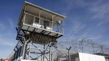 An Israeli prison guard keeps watch from a tower at Ayalon prison in Ramle near Tel Aviv, Feb. 13, 2013. (Nir Elias/Reuters)