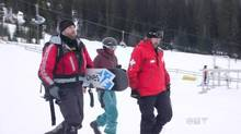 A woman from Washington State is escorted to safety after being rescued at Sun Peaks resort in B.C. (CTV)