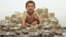 Baby sitting on pile of money (Comstock/Getty Images/Comstock Images)