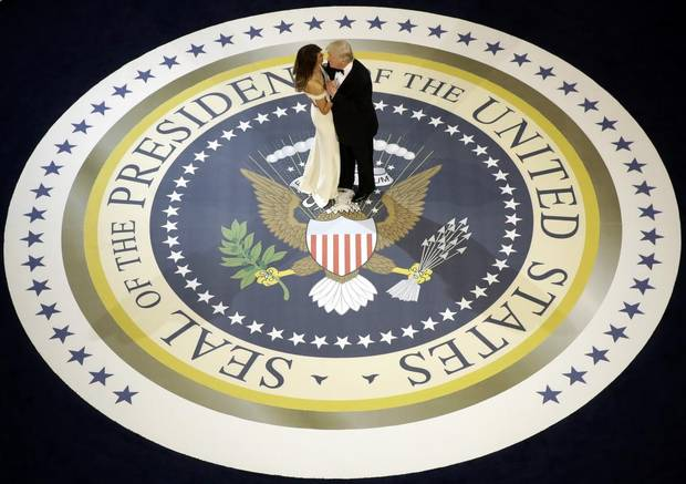 President Donald Trump dances with first lady Melania Trump, at The Salute To Our Armed Services Inaugural Ball in Washington, Friday, Jan. 20, 2017.