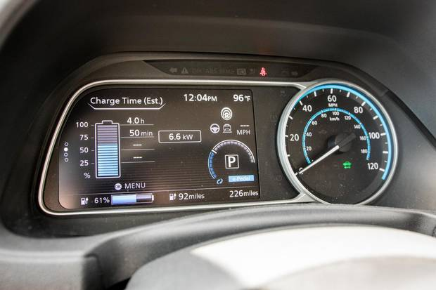 Dash displays show the Leaf's current charge and estimated remaining range.