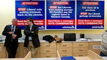 British Columbia Conservative party leader John Cummins, left, waits for by-election results at Conservative candidate John Martin's campaign office in Chilliwack, B.C., April 19, 2012. (Darryl Dyck For The Globe and Mail)